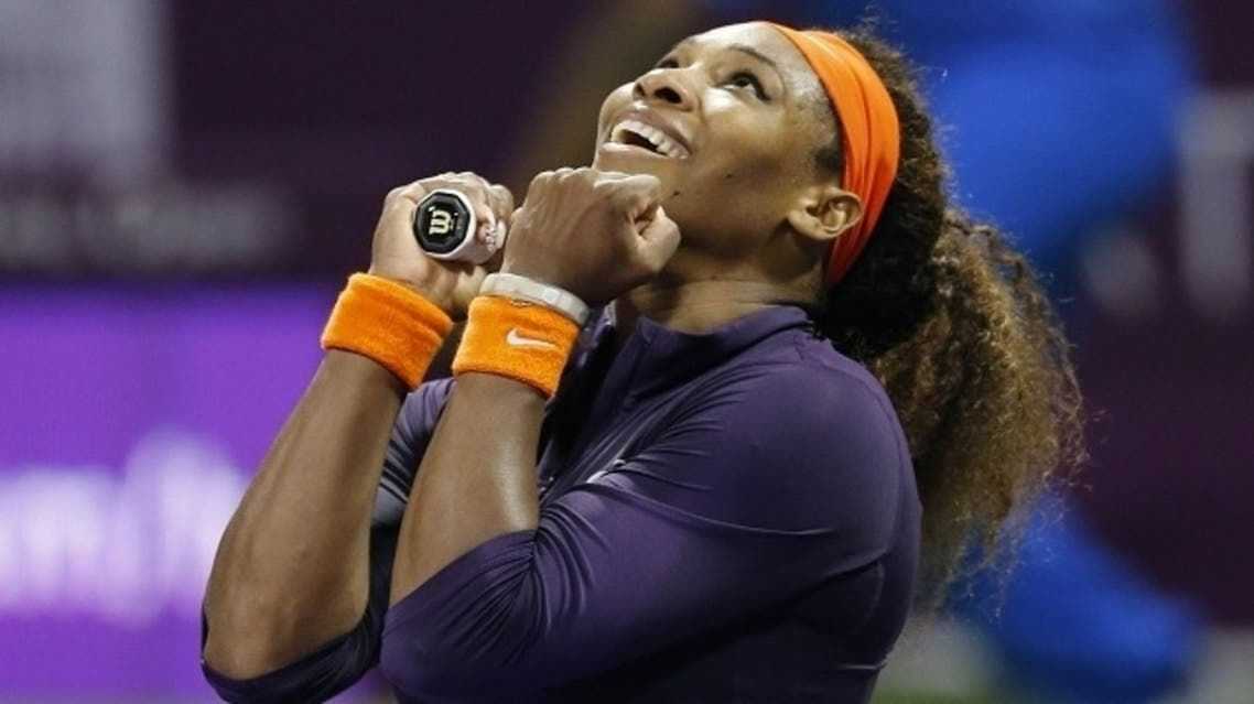 Serena Williams of the U.S. reacts after defeating Petra Kvitova of the Czech Republic during their women's quarter-final match at the Qatar Open tennis tournament in Doha Feb. 15, 2013. (Reuters)