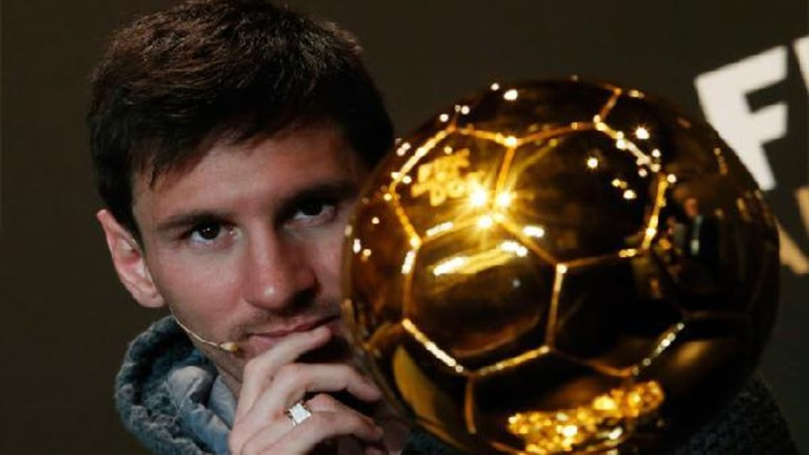 FIFA Men\'s Ballon d\'Or of the Year 2012 winner Lionel Messi of Argentina watches the trophy during a news conference before the FIFA Ballon d\'Or 2012 soccer awards ceremony at the Kongresshaus in Zurich. (Reuters)