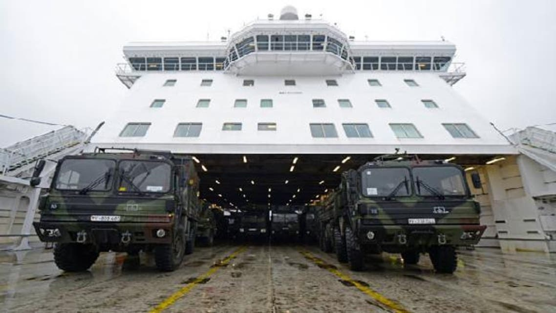 Military vehicles of a Patriot missile system are loaded on a ship in the harbour of Travemuende, January 8, 2013. Germany, the Netherlands, and the United States are each sending two Patriot missile batteries and up to 400 troops to Turkey after Ankara asked for NATO's help to bolster security along its 900-km (560-mile) border with Syria. (Reuters)
