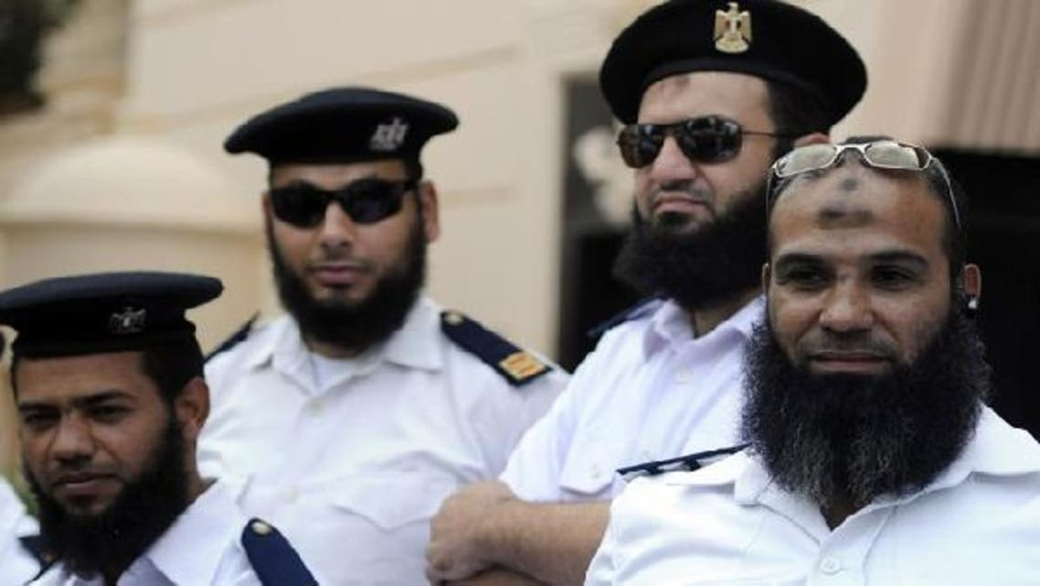 A group of bearded policemen take part in a protest in uniform in front of Interior Ministry building in Cairo, Egypt. (Reuters)