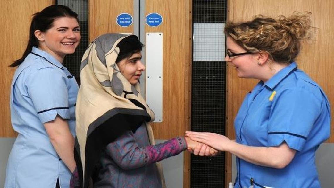 Pakistani schoolgirl Malala Yousufzai (C) smiles with nurses as she is discharged from The Queen Elizabeth Hospital in Birmingham in this handout photograph released on Jan. 4, 2013. (Reuters)