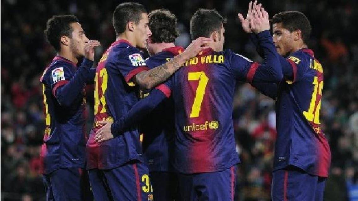 لاعبو برشلونة يحتفلون بهدف فيا في مرمى ألافيس