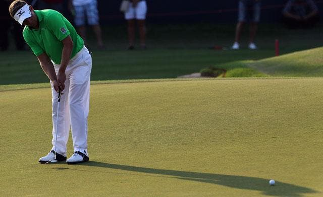 Luke Donald of England putts the ball during the first round of the DP World Tour Championship in Dubai. (File photo: AFP)