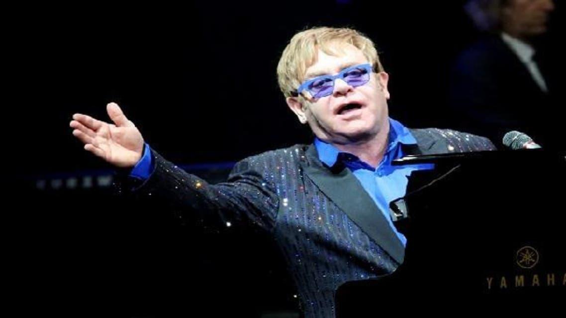 This picture taken on Nov. 25, 2012 shows pop-rock balladeer Elton John performing at his concert in Wukesong Stadium in Beijing. (AFP)