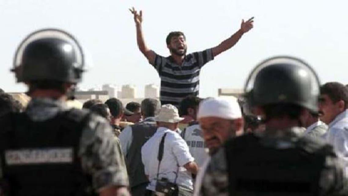 شامی مہاجرین اردنی کی سرحد کے نزدیک صدر بشار الاسد کے خلاف احتجاجی مظاہرے میں شریک ہیں