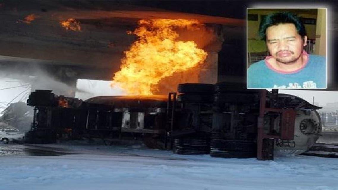 تباہ شدہ گیس ٹنیکر اور ان سیٹ میں ڈرائیور رابن کی تصویر
