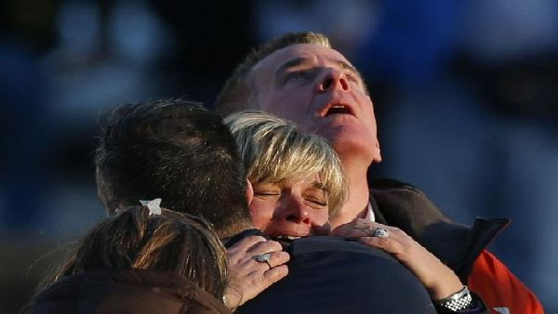 The families of victims grieve near Sandy Hook Elementary School, where a gunman opened fire on school children and staff in Newtown, Connecticut on December 14, 2012. A heavily armed gunman opened fire on school children and staff at a Connecticut elementary school on Friday, killing at least 26 people, including 20 children, in the latest in a series of shooting rampages that have tormented the United States this year. (Reuters)