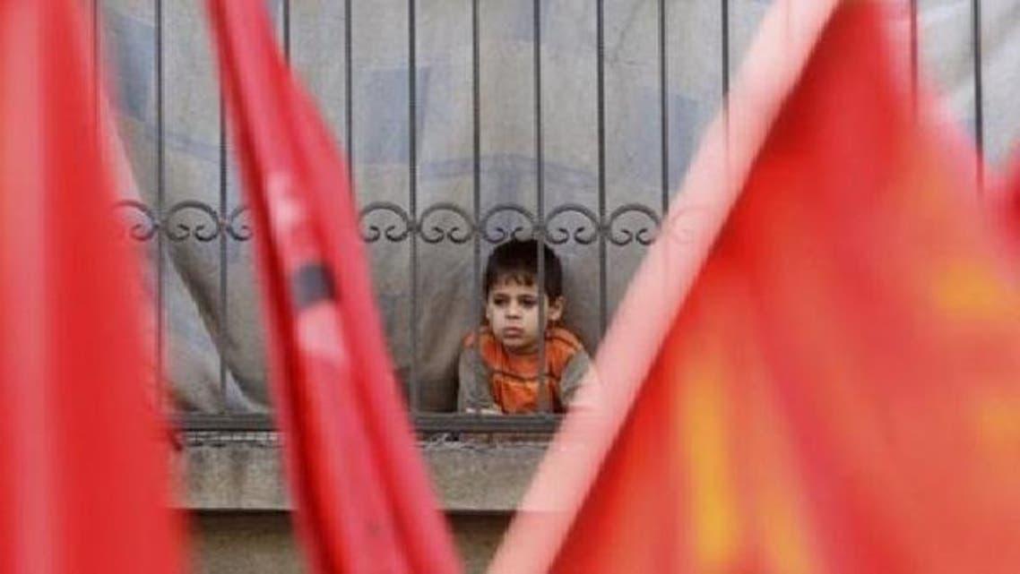 فلسطینی مہاجر کیمپ میں مقیم ایک بچہ۔