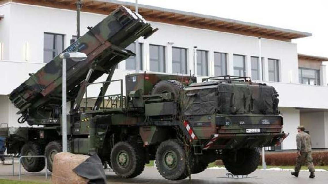 Soldiers of the German Air Defence Missile Squadron 2 walking past Patriot missile launchers in the background in Bad Suelze, northern Germany. (AFP)