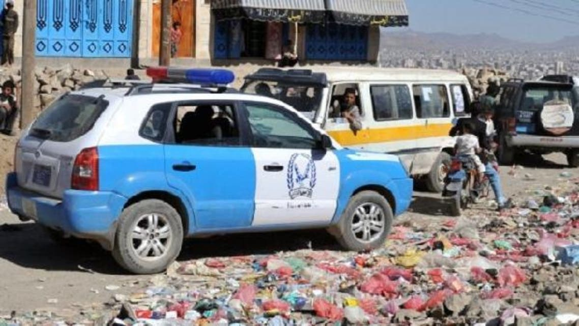 Yemeni police arrives to the scene  where U.S. Embassy official was shot by masked gunmen as heading to work Thursday morning in Sana\'a. (AFP)