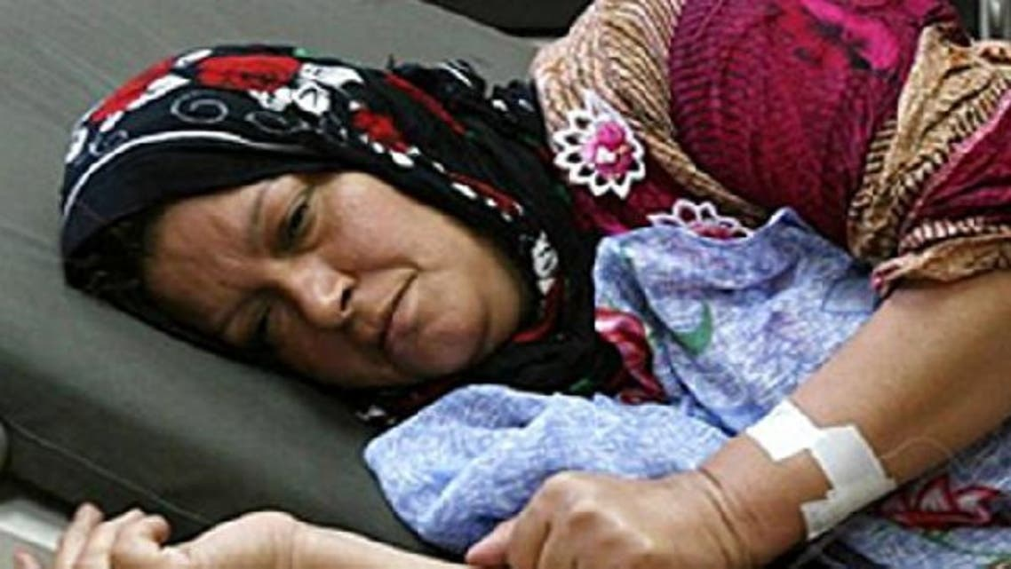 Cholera is not uncommon in Iraq. Majida Hamid Ibrahim, the first confirmed cholera case in Iraq back in 2007, is seen lying in a hospital bed.  (Photo courtesy AP)
