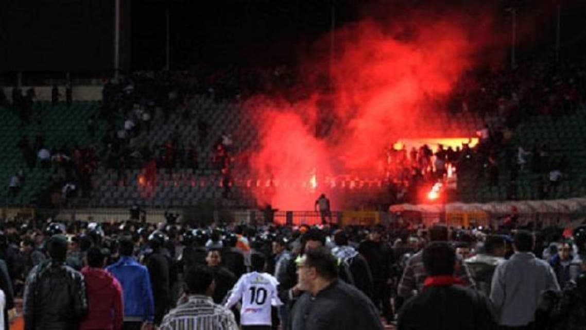 Egyptian fans rush onto the field following the Al-Ahly club football match against Al-Masry club at Port Said Stadium,the ensuing violence saw 74 people killed, Port Said, Egypt, Wednesday, Feb. 1, 2012. (AP)