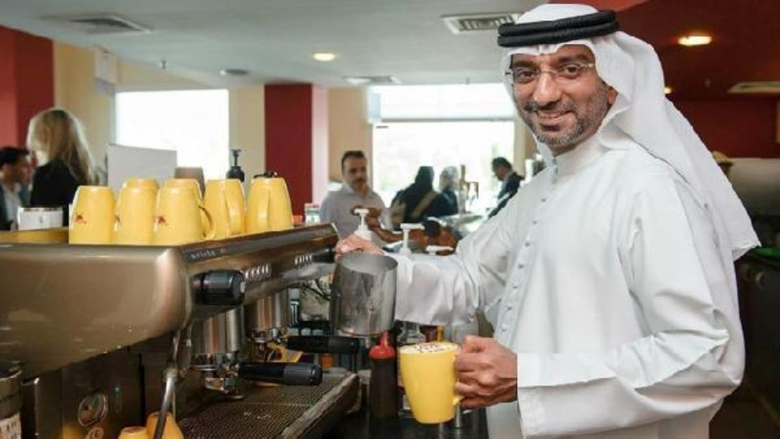 Camellos and Cafe2Go founder and owner, Jassim Al Bastaki, trying new camel milk products at his own café. (Photo courtesy: Café2go Middle East Facebook page)
