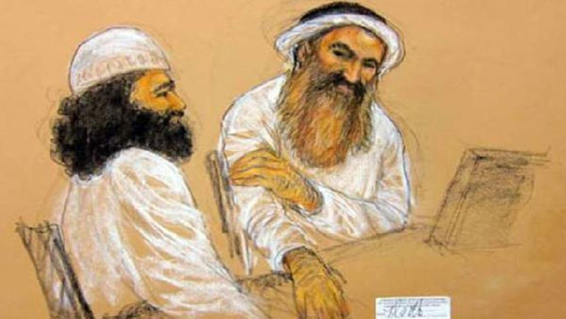 With his orange beard, Khalid Sheikh Mohammed appears at his arraignment in this courtroom sketch. (Reuters)