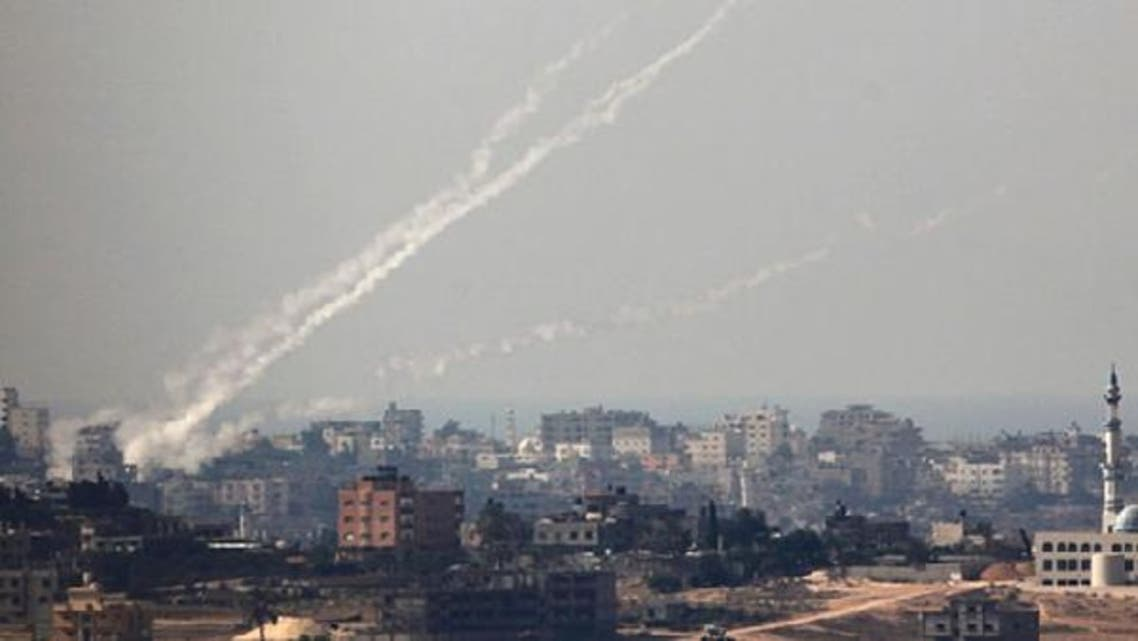 Trails of smoke are seen after the launch of rockets from the northern Gaza strip towards Israel October 24, 2012. (Reuters)