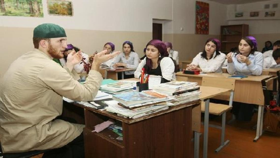 Islam Dzhabrailov, a teacher, is seen gesturing to students. Dzhabrailov is cooperating with Chechen leader Ramzan Kadyrov to combat Islamist insurgency by implementing his own brand of Islam. (Reuters)
