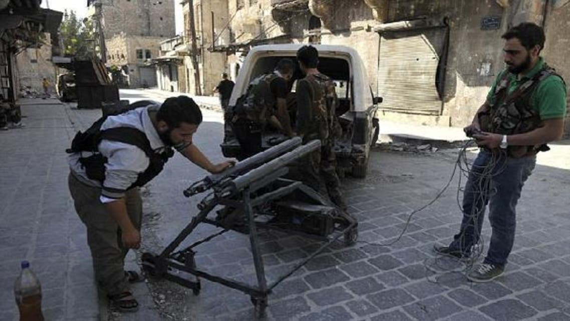 Rebels prepare a homemade mortar-launcher in Aleppo, which is fired using a PlayStation controller. (AFP)