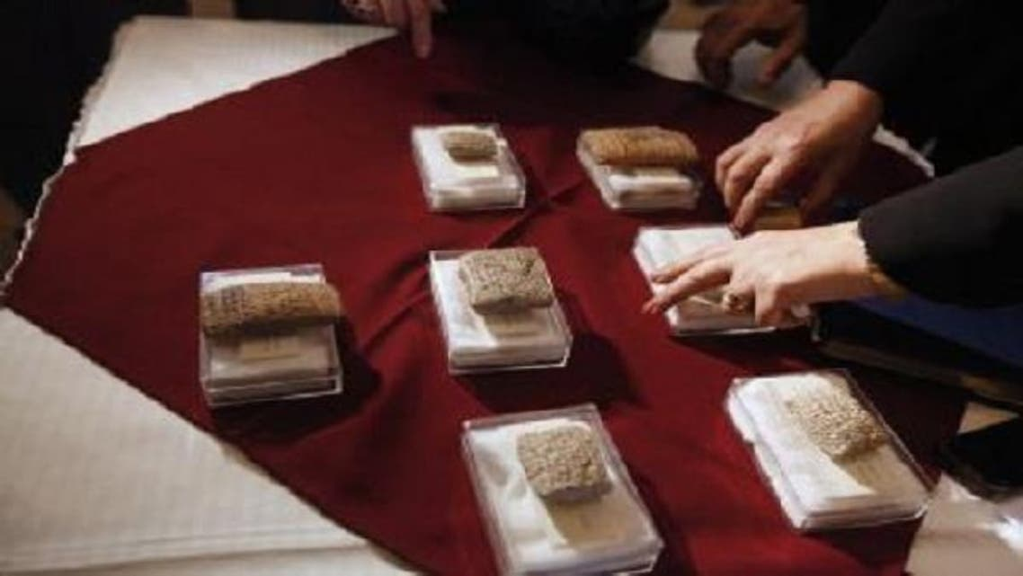 Iraqi police arrested two smugglers in possession of stolen antiquities from the northern Dhiqar Province. (Reuters)