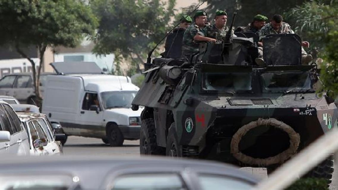 Lebanese soldiers patrol a street in the northern city of Tripoli. (AFP)