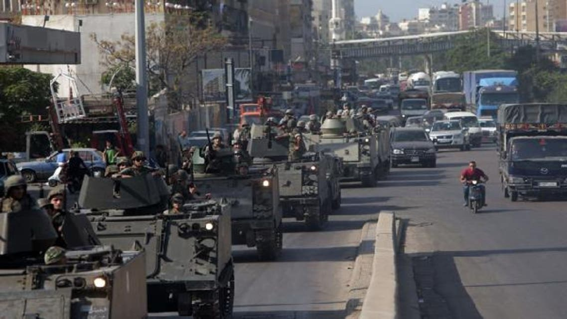 Lebanese army tanks deploy in the Bab al-Tabbaneh and Jabal Mohsen neighborhoods where clashes were taking place in the coastal city of Tripoli, northern Lebanon. (AFP)
