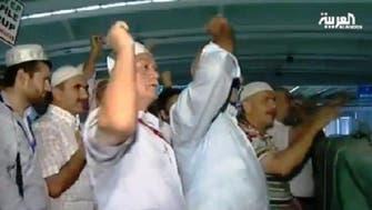 Turkish pilgrims perform the ritual of stoning the devil
