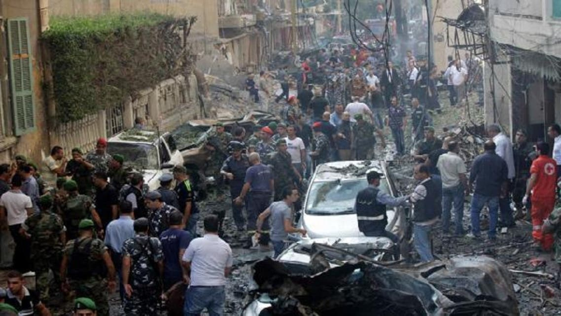 Lebanese forensic experts and security forces inspect the site of an explosion in Beirut\'s Christian neighbourhood of Ashrafiyeh. (Reuters)