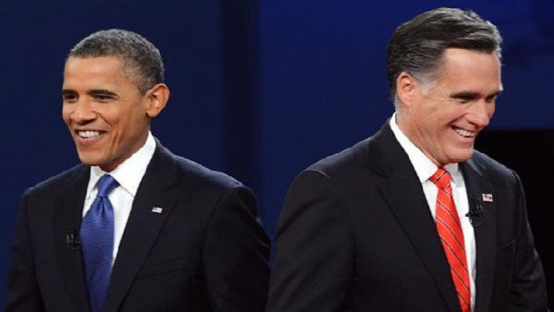Republican presidential candidate Mitt Romney (R) and U.S. President Barack Obama after the presidential debate. (AFP)