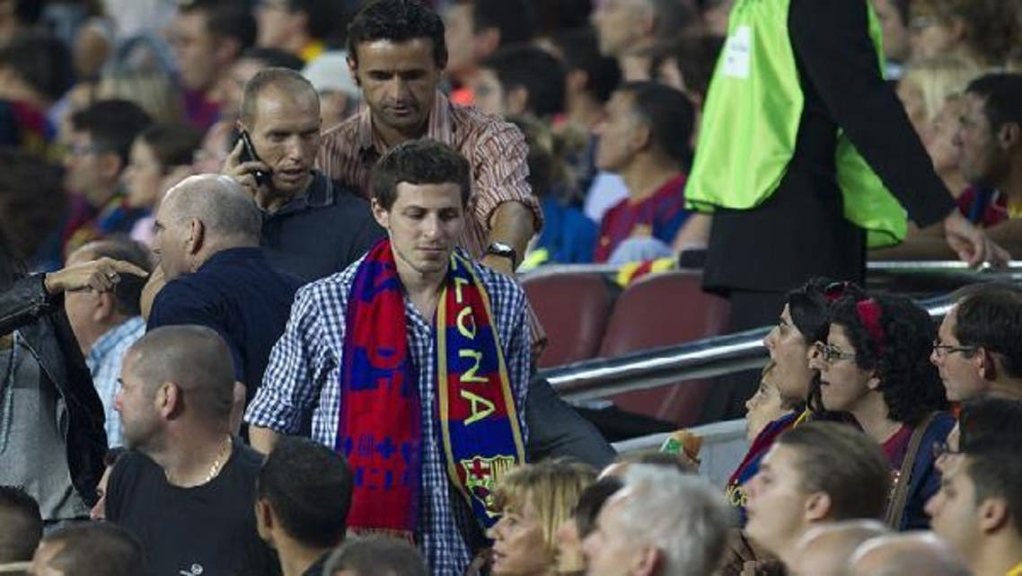 Israeli soldier Gilad Shalit (C) arrives to take a seat in the grandstand during the Spanish League Clasico football match Barcelona vs Real Madrid. (AFP)
