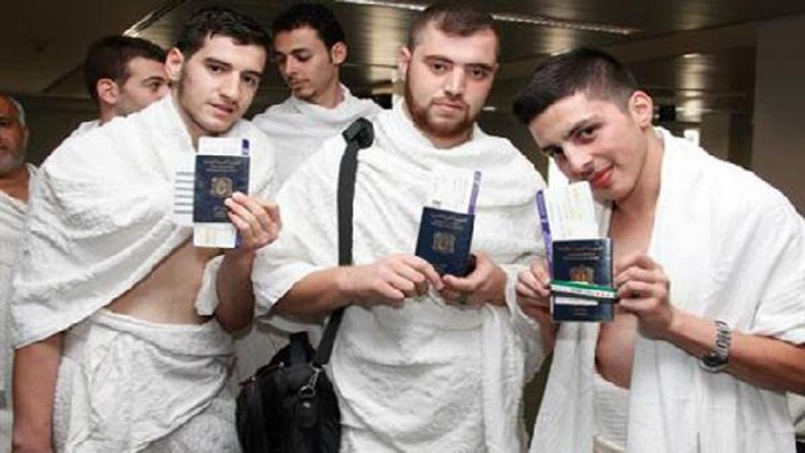 Syrian pilgrims at Beirut airport show their passports before heading to Jeddah, Saudi Arabia to perform Hajj. (Photo courtesy The Daily Star)