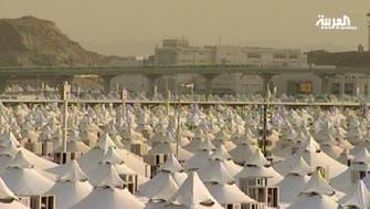Hajj pilgrims prepare their pebbles for stoning ritual