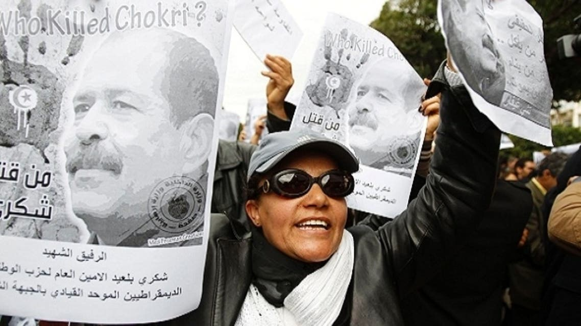 A woman chants slogans and holds pictures of assassinated leftist politician Chokri Belaid during a demonstration against the Islamist Ennahda movement in Tunis February 23, 2013. (Reuters)