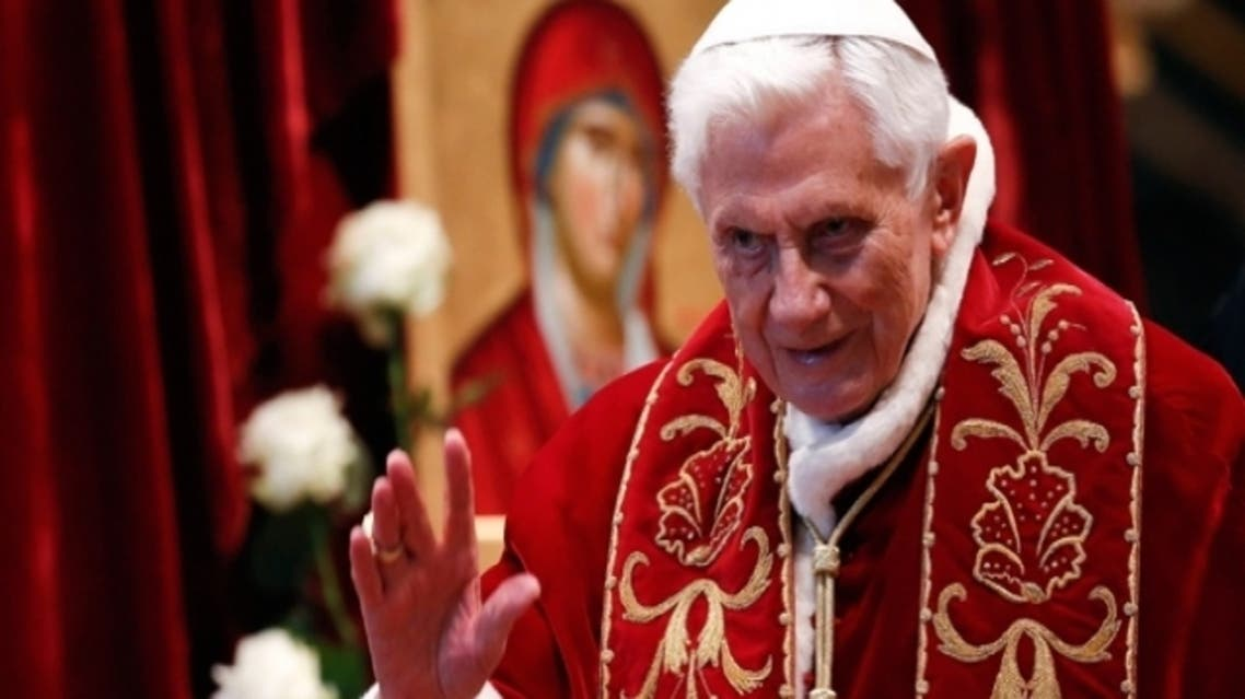 Pope Benedict XVI waves during a mass conducted by Cardinal Tarcisio Bertone on Feb. 9, 2013. (Reuters)