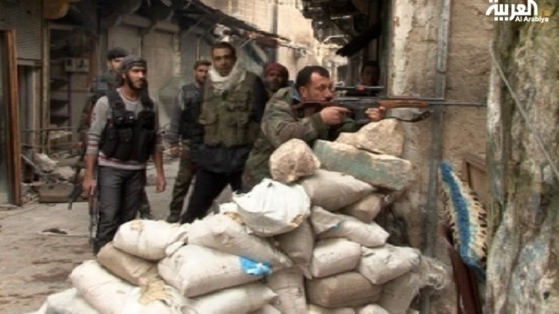 The Commander of the Battalion of Free Syrians took Al Arabiya correspondent in a tour inside one of the weapons stores. (Al Arabiya)