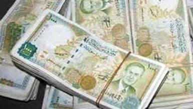 مخاوف انهيار الليرة يدفع السوريين إلى شراء مكثف للدولار
