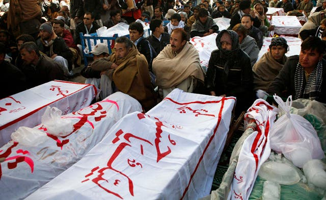 Shi\'ite Muslims display the unburied coffins of victims of Thursday\'s twin bomb attack during a sit-in in Quetta January 12, 2013.  (Reuters)