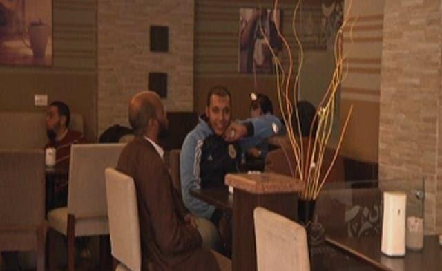 Men sit together in D. Cappucino café