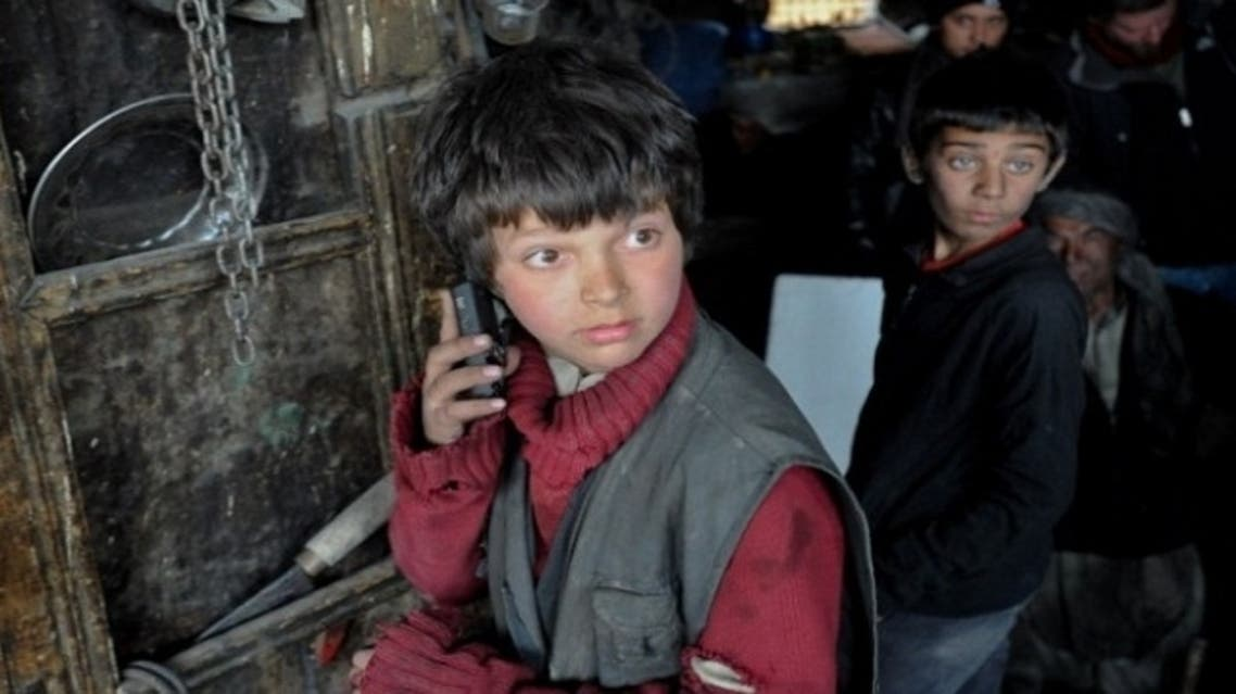 """Oscar-nominated, """"Buzkashi Boys,"""" filmed entirely in a war zone in Afghanistan, shows actors Jawanmard Paiz, front and Fawad Mohammadi on the set of the film. (Photo Courtesy: The official website for """"Buzkashi Boys"""")"""