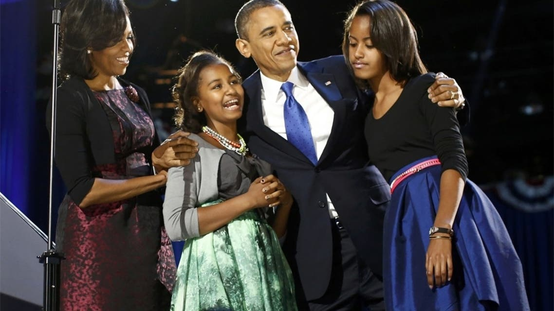 الرئيس باراك أوباما وزوجته وابنتيه