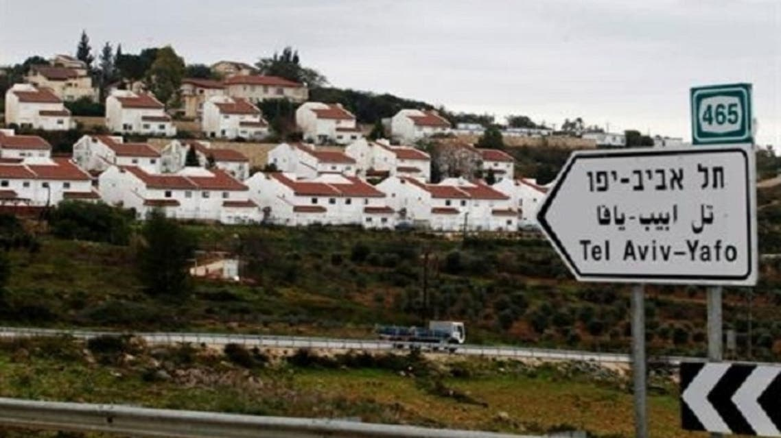 Houses in the Jewish settlement of Halamish are seen from a road near West Bank city of Ramallah Feb. 1, 2013. (Reuters)