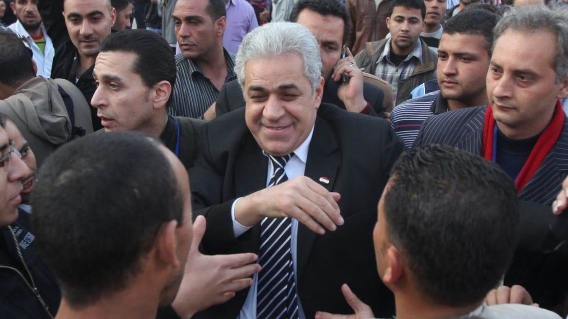 Egyptian potential presidential candidate, Hamdeen Sabahi (R) talking to people during one of his presidential campaign tours in central Cairo. (Reuters)