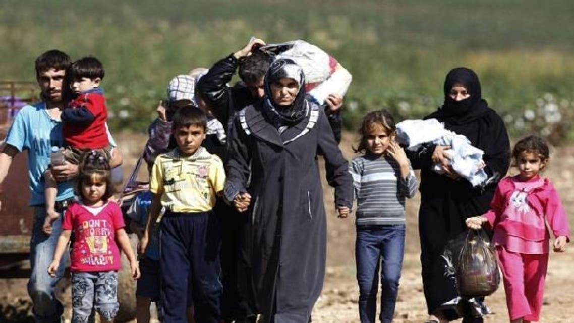 More than 700,000 Syrian refugees have registered in neighboring countries as the conflict in their war-torn nation spirals further out of control. (Reuters)