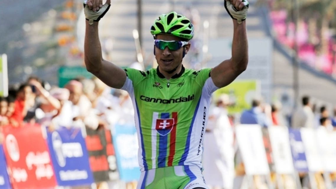 Cannondale rider Peter Sagan of Slovakia celebrates near the finish line during the 146km (90.7 miles) second stage of the Tour of Oman cycling race from Fanja in Bidbid to Al Bustan, in Muscat February 12, 2013. (Reuters)