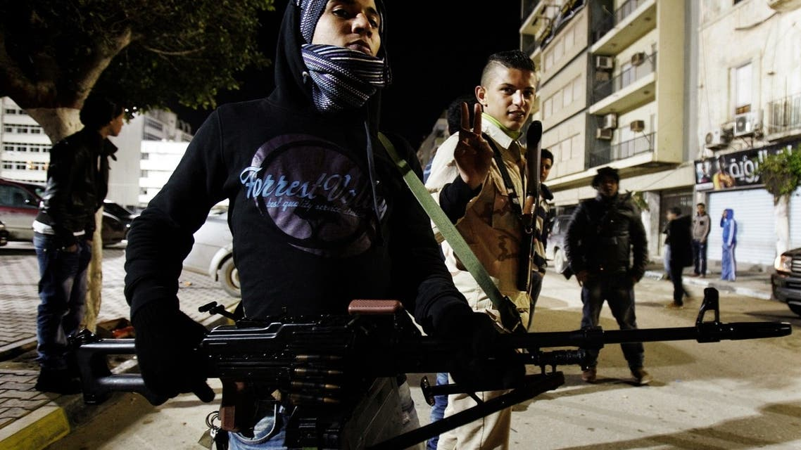 Armed Libyan civilian's man a checkpoint in one of the streets of Benghazi on February 11, 2013, as Libyans formed small armed to protect their neighborhood from possible threats as the 2nd anniversary of the Libyan revolution is few days away. (AFP)