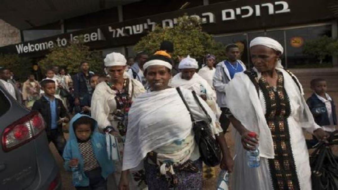 Ethiopian migrants arrive at Tel Aviv's Ben Gurion airport on Jan. 17, 2011 (AFP)