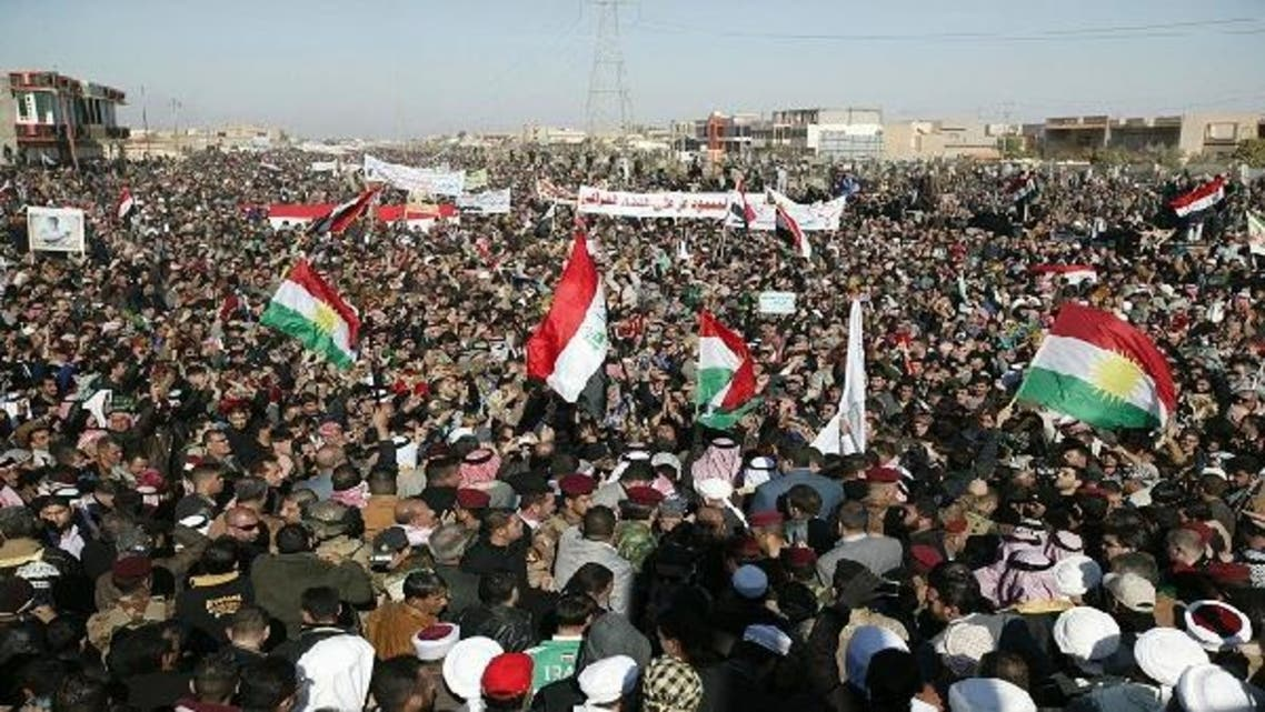 Iraqi protesters take part in a demonstration in the central city of Samarra January 11, 2013. (Reuters)