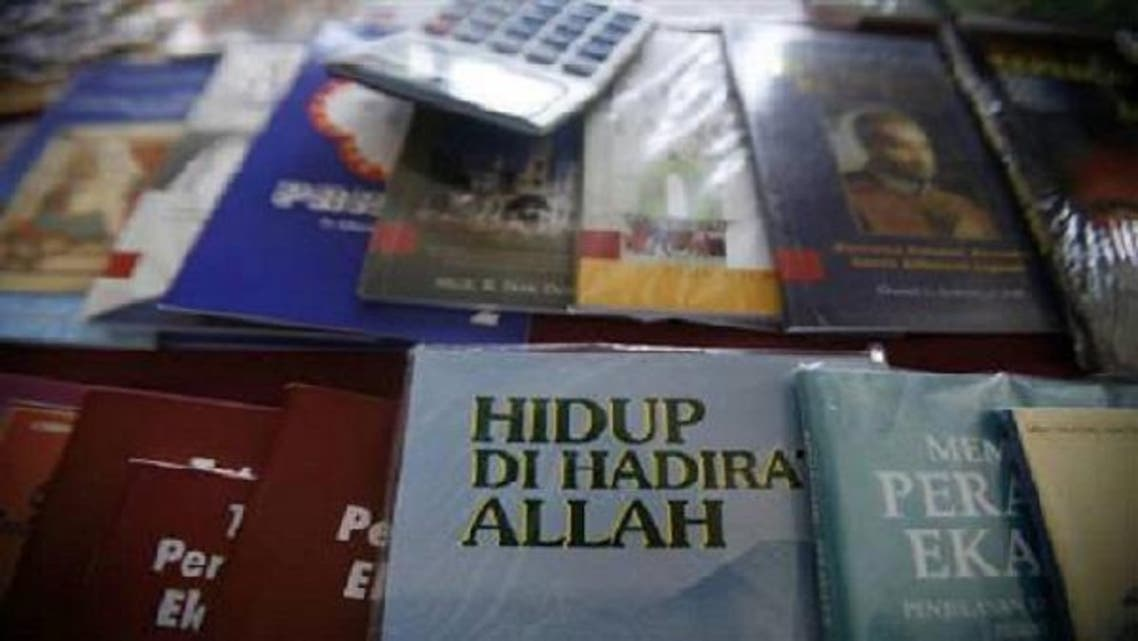 """A Christian book entitled """"Live With the Presence Of Allah"""" is on sale at St Francis Xavier Cathedral in Malaysia's eastern state of Sabah on Borneo island, February 22, 2009. (Reuters)"""