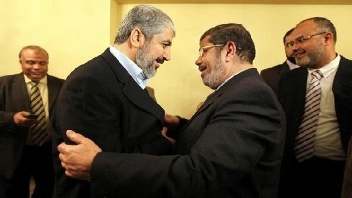 """Mursi's Cairo office said Abbas and Meshaal will first \\""""meet Egypt\'s intelligence chief before holding a three-way meeting with President Mursi.\\"""" (Courtesy: AP)"""