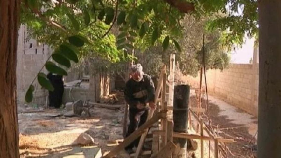 A man from Jericho doesn\'t let his blindness deter him from doing construction work on his own home and that of his neighbors. (Reuters)