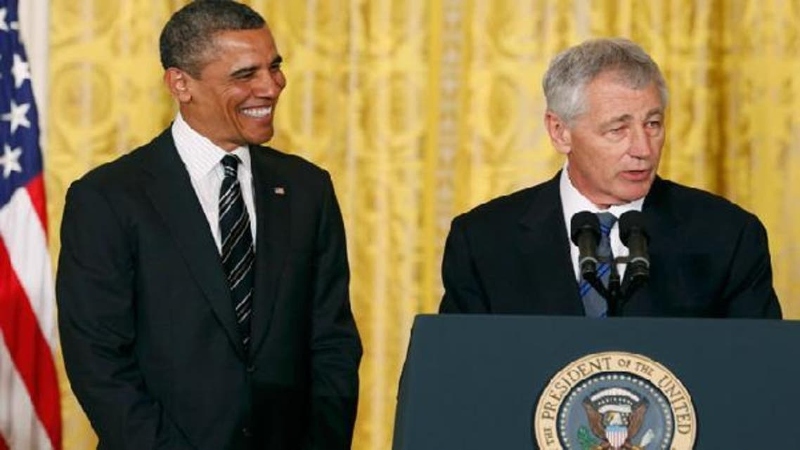U.S. President Barack Obama smiles at his nominee for Secretary of Defense, former Republican Senator Chuck Hagel (R), at the White House in Washington January 7, 2013. (Reuters)