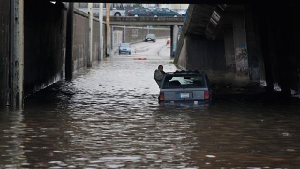A driver sits in his stranded car on a flooded highway, waiting for help, during a winter storm in Beirut January 7, 2013. (Reuters)